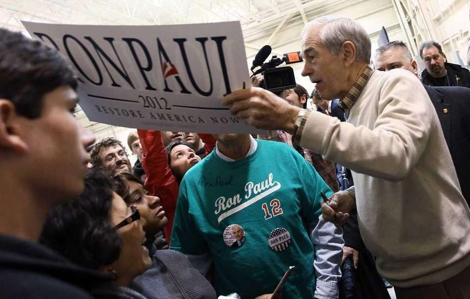 Republican presidential candidate Ron Paul greets supporters at