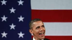 President Barack Obama sings before speaking at a