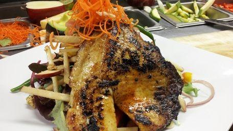 Blackened tilapia salad at Cedarhurst Cafe in Cedarhurst.