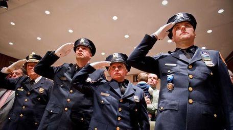 (L-R) Police officers Joseph D'Alessandro, Angela Ferrara, and