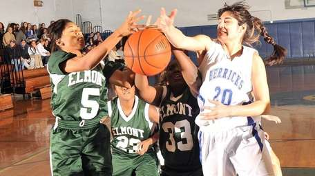 Elmont players (from left) #5 Kyla Ridley, #23