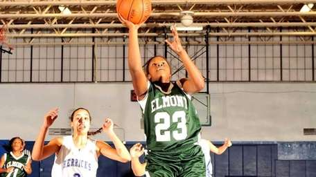 Elmont's #23 Bria Fisher drives the paint for
