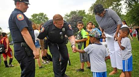 Nassau County Police Officers Eddie Hocton, left, and