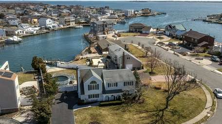 This Copiague home on a canal is listed