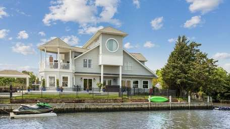 This Bayport home on a canal is listed