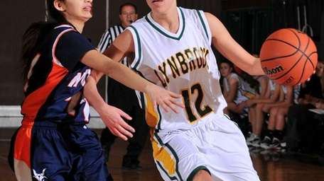 Lynbrook High School guard Brooke Gerstman, right, looks
