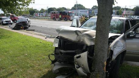 A sport utility vehicle crashed into a tree