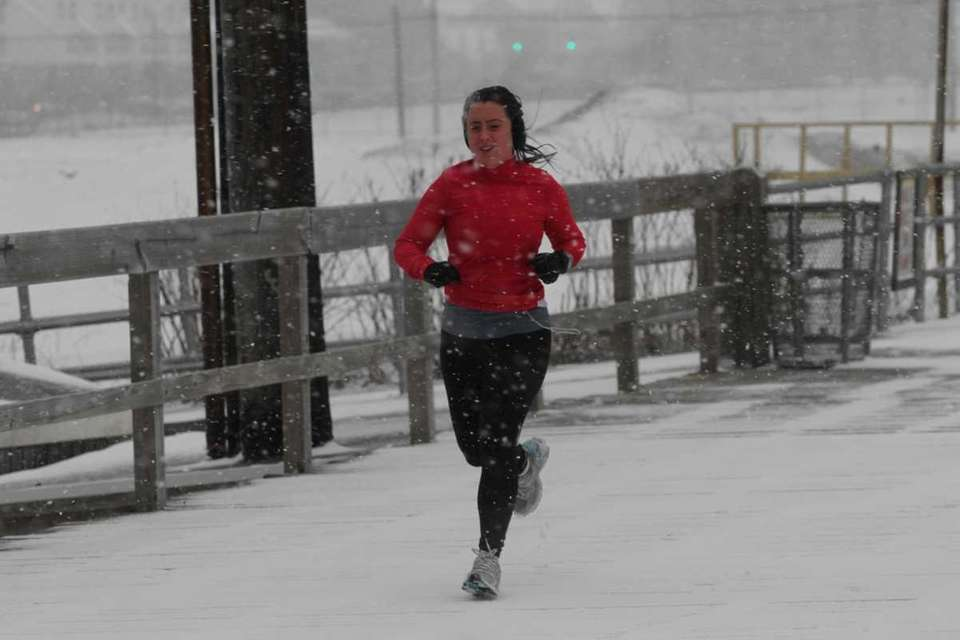 The year's first snowstorm doesn't stop this runner