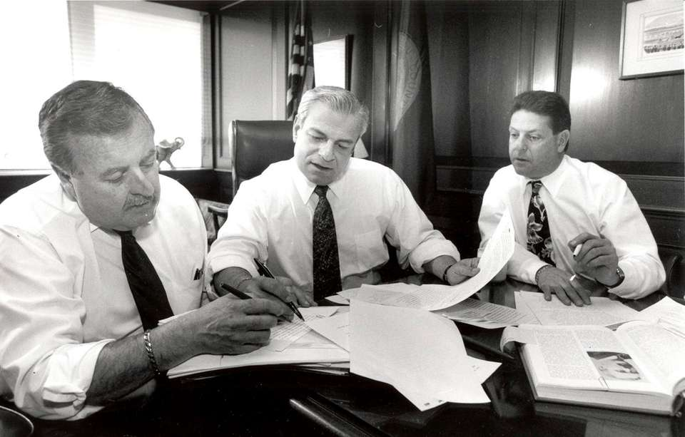 Then-Nassau County Executive Thomas Gulotta, center, works with