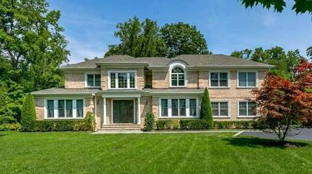This Kings Point Colonial is listed for $3.288
