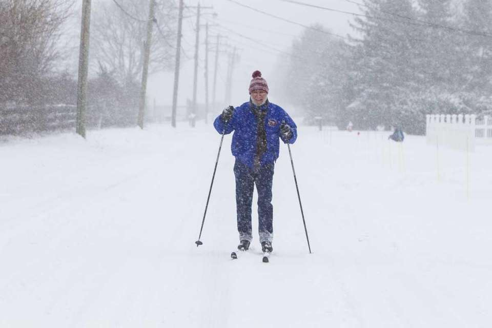 Tom Festa of Aquebogue tries out skis he