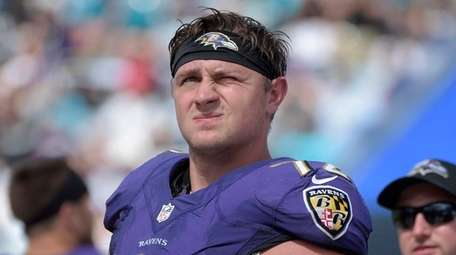 Ravens offensive guard Alex Lewis watches from the
