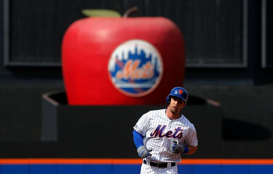 The Mets' Jeff McNeil runs the bases after