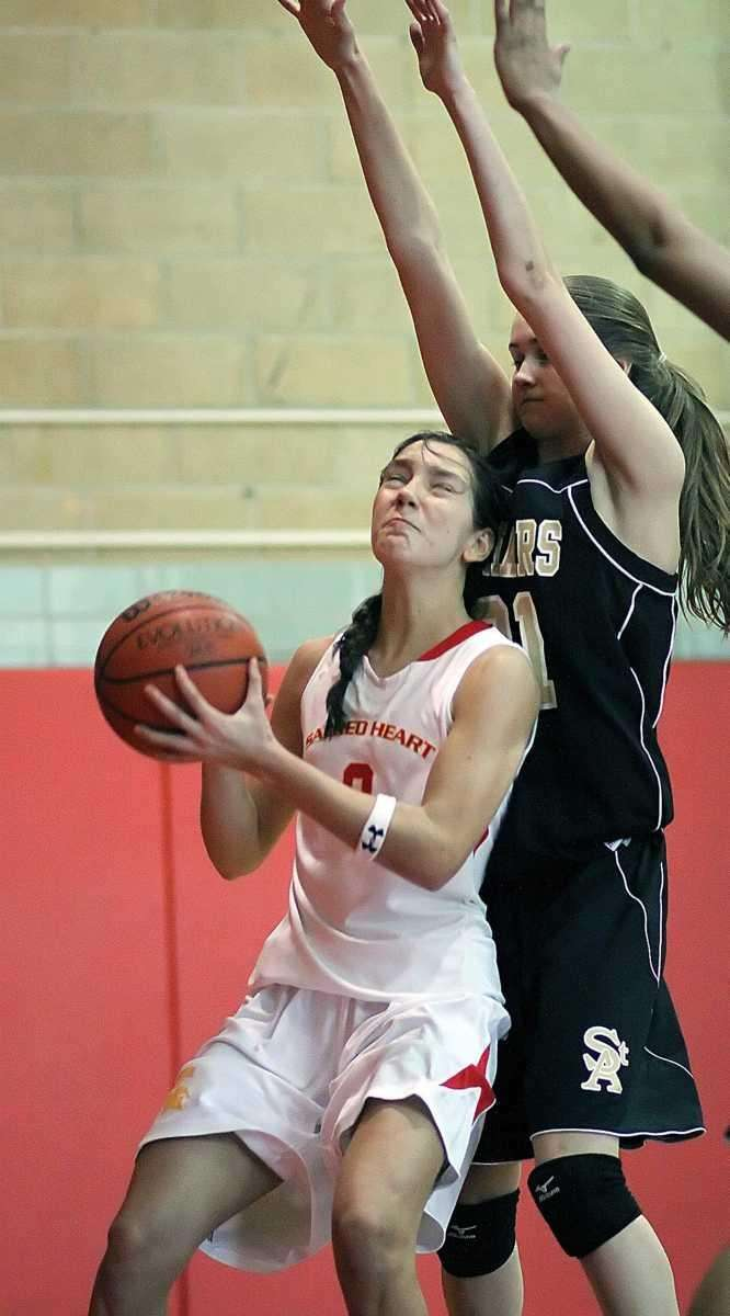 Sacred Heart's Nina Corcoran works against St. Anthony's