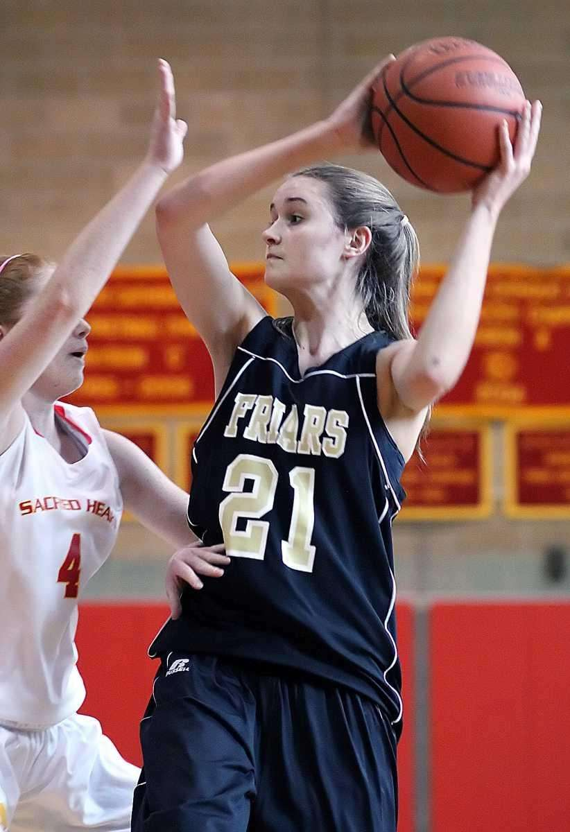 St. Anthony's Johanna Impellizeri gets defended by Sacred