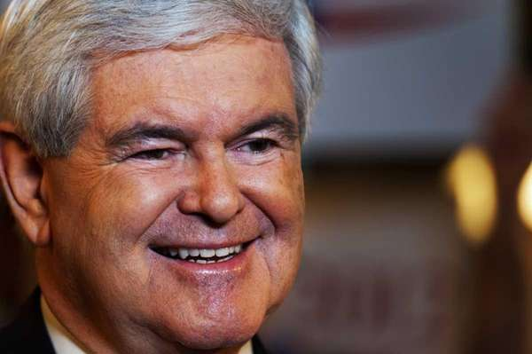 Republican presidential hopeful Newt Gingrich smiles during a