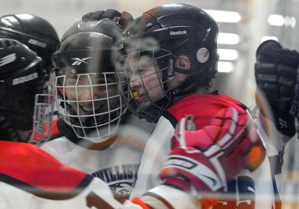 East Williston's Matthew Bernot, right, gets congratulated by