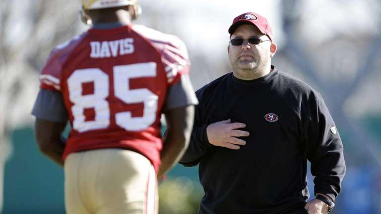 San Francisco 49ers offensive coordinator Greg Roman, right,