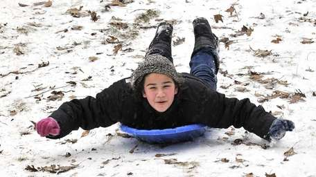 Eleven-year-old Katie Elefteriadis of South Farmingdale sleds down