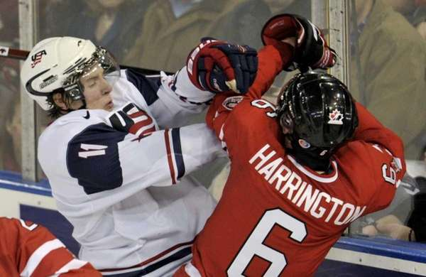 Canada defenseman Scott Harrington and U.S. forward JT