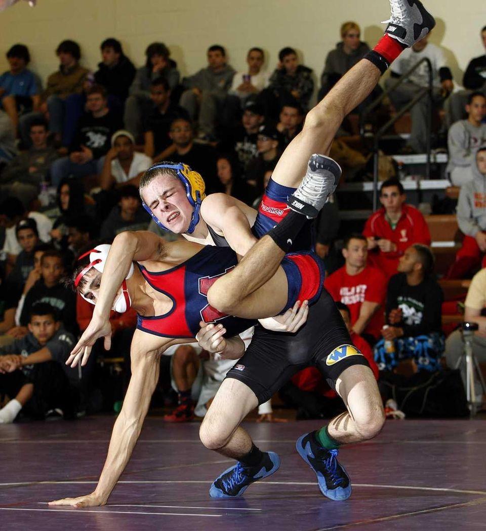 West Islip's Tyler Walsh drops MacArthur's Anthony Boccasini