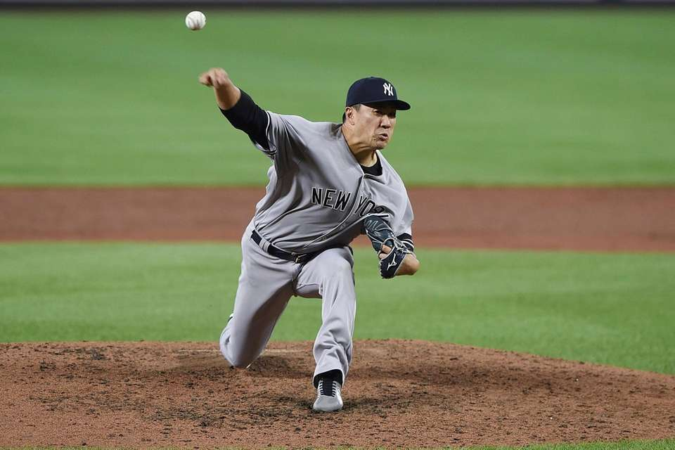 Yankees pitcher Masahiro Tanaka delivers against the Orioles