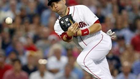 Boston Red Sox's Marco Scutaro throws to first