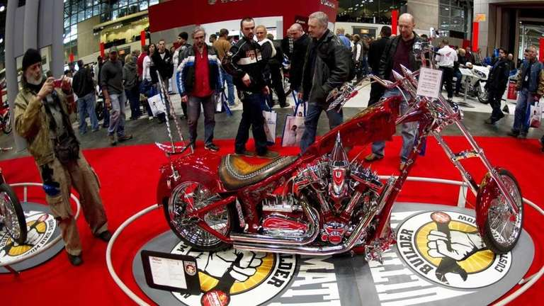 Motorcycle fans check out the bikes at the