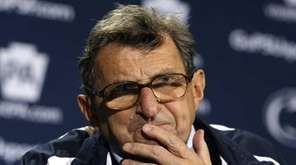 Penn State head coach Joe Paterno pauses during