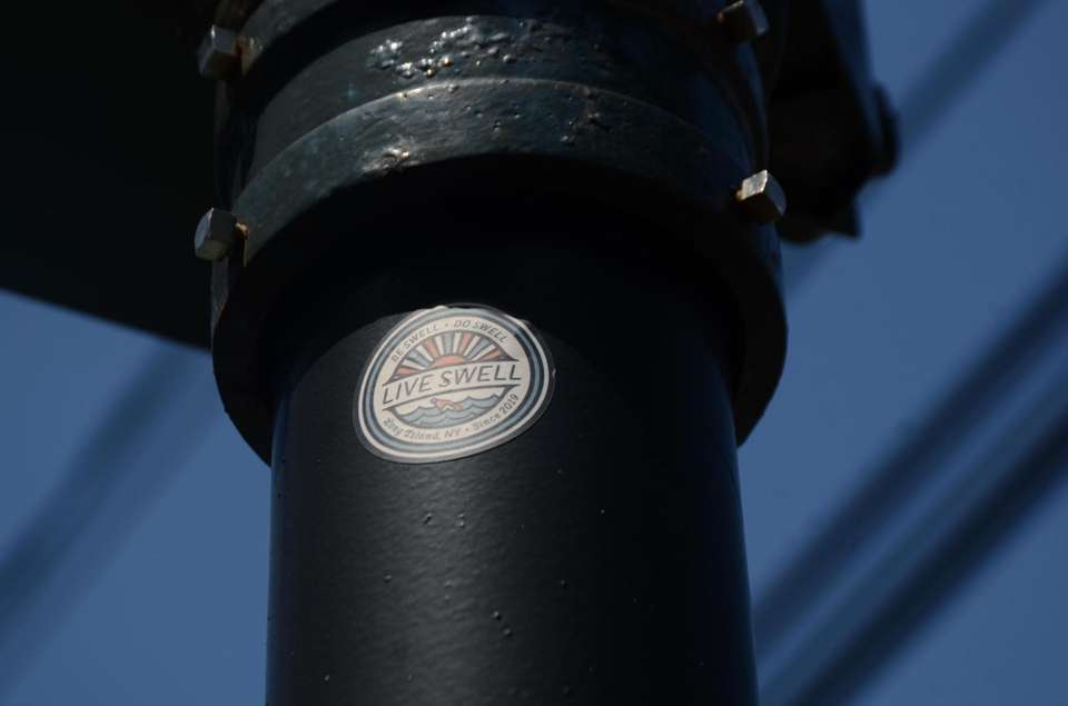 """Live Swell"" sticker sits on a telephone pole"