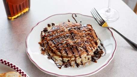 Samoa pancakes topped with toasted coconut flakes, chocolate