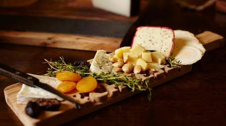A cheese flight with Red Dragon, Truffle Tremor,