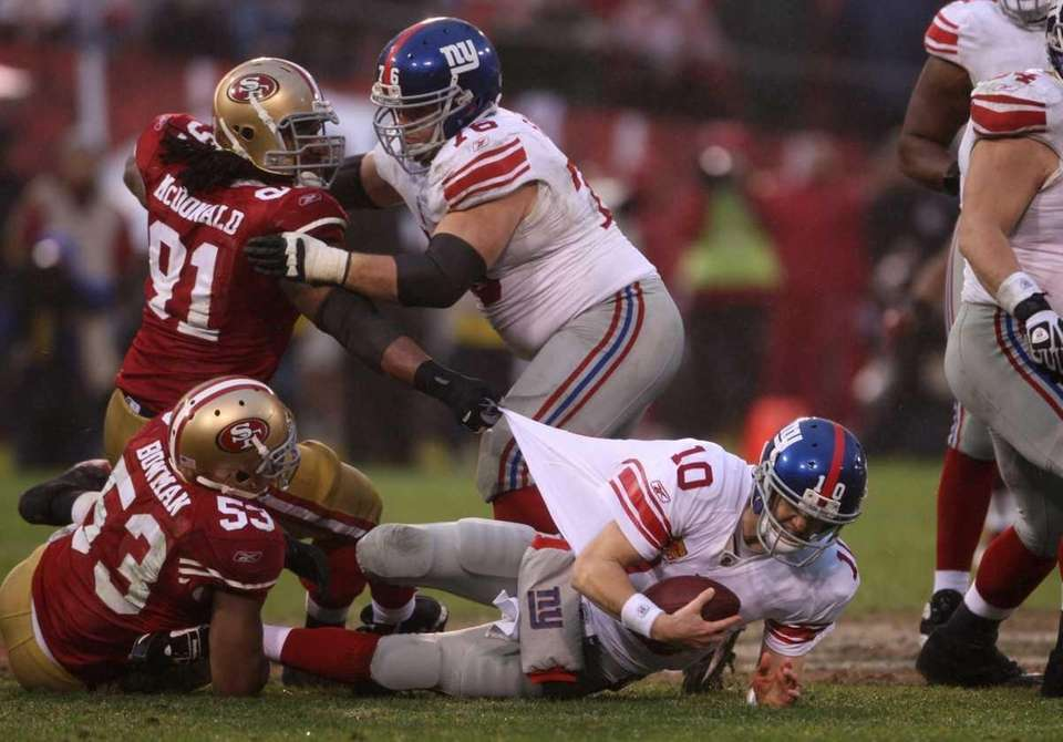 New York Giants' quarterback Eli Manning is sacked