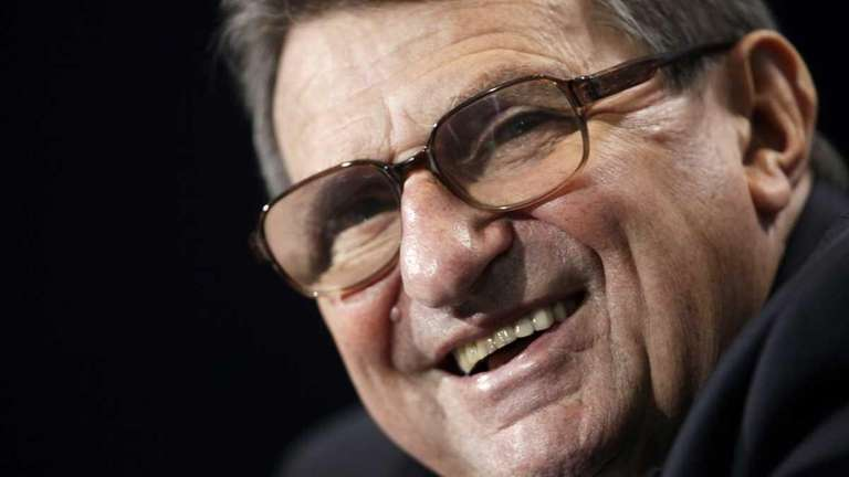 Penn State football coach Joe Paterno laughs during