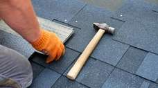 The decision to repair or replace a roof