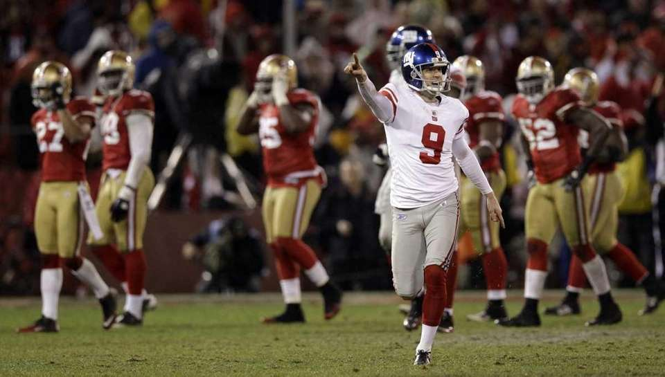 New York Giants' Lawrence Tynes reacts after kicking