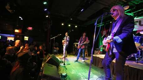 Mike Epstein, Smithtown, leads the Tom Petty Tribute