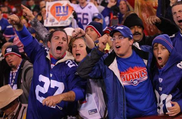 New York Giants fans celebrate after the Giants