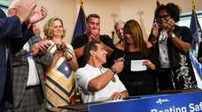 Gov. Andrew M. Cuomo gives a pen he