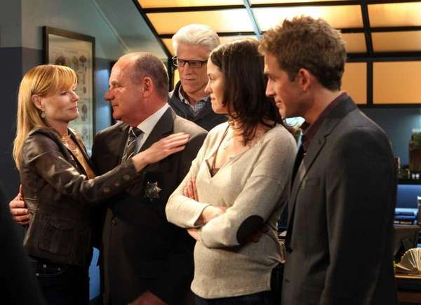 Marg Helgenberger, left, hugs Capt. Jim Brass as