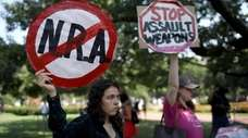 Gun-control activists Tuesday in a park across from