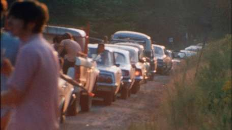 With nowhere for cars to go, Woodstock concertgoers