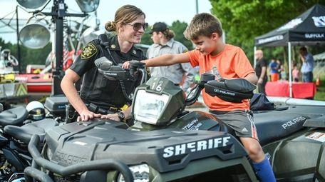 Suffolk County Deputy Sheriff Patrice Silvestri shows Matthew