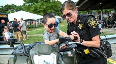 Suffolk County Deputy Sheriff Patrice Silvestri shows four
