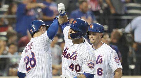 Mets catcher Wilson Ramos (40) celebrates with third
