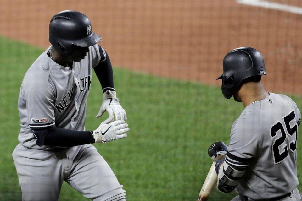 Yankees' Didi Gregorius, left, celebrates his solo home