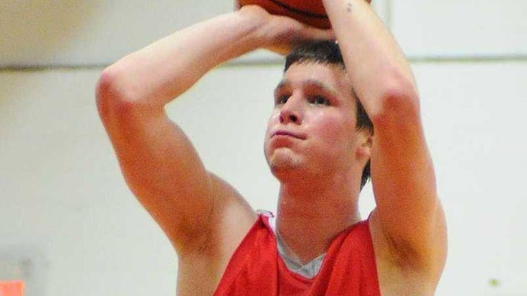 East Islip High School's Evan Maxwell drains a