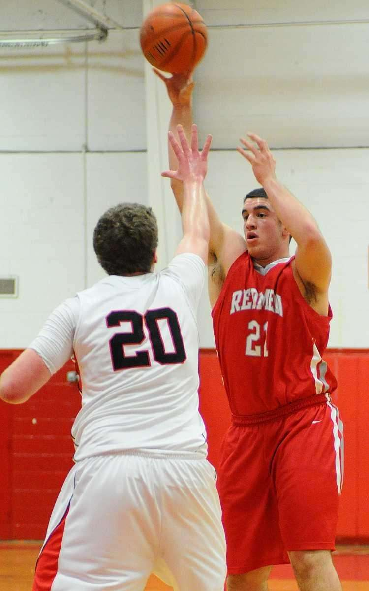 East Islip High School's Mike White, right, passes