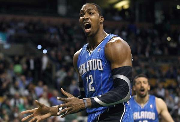 Orlando Magic center Dwight Howard (12) reacts after