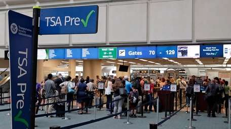 Passengers heading to their departure gates enter TSA